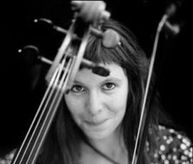 Helen Gillet posing with her cello